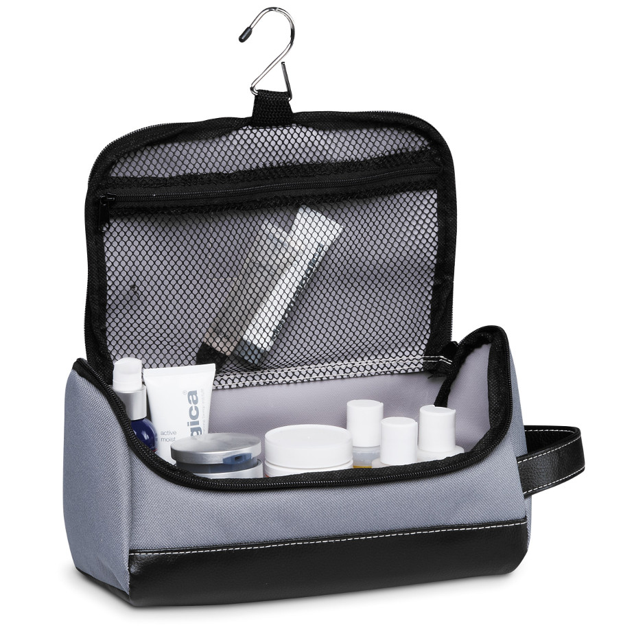 The Graphite Toiletry Bag Is Made From 600D And PU.The Features Include A Main Zippered Compartment With An Interior Mesh Zip Pocket, 2 Side Zippered Pockets And An End Grab Handle With A Hanging Swivel Hook.