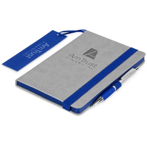 The Colourblock A5 Notebook is a grey thermo PU hardcover notebook with 192 lined pages and a brightly coloured blue matt laminated bookmark, page edges, pen loop and elastic band closure