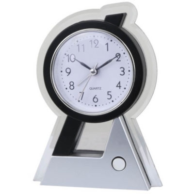 The Tower Alarm Clock & Light is a silver plastic desk clock with a black frame, circular display, black numbers and pointy arms with an alarm and light function and an on/off button