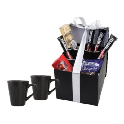 This Coffee Hamper contains 2 x Cone Mugs, , 1 x packet of Whispers, one box of Ferrero Rocher, one Lindt Lindor Box and 4 x Cappuccino Sachets
