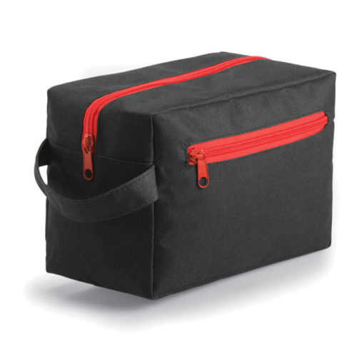 The red Compact Toiletry Bag is made from 600 denier polyester. The bag features a carry handle, a main compartment and a side pocket with a zip opening.