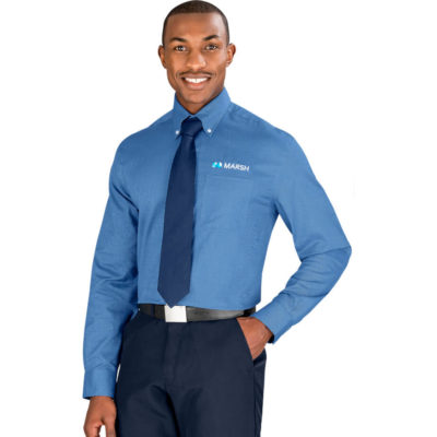 The blue Mens Long Sleeve Epic Shirt has single button sleeve plackets, single button adjustable cuffs, pearlised logo buttons and a curved hemline. There is also a left chest pocket and embroidered tone-on-tone CB logo on the left cuff on the sleeve. The wrinkle-resistant finish is what makes the shirt look so good.