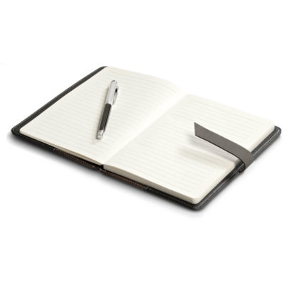 The Windsor Midi Notebook is a black PU and simulated leather cover notebook with 104 lined pages and strap closure