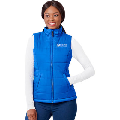 The Ladies Evolution Bodywarmer is a nylon sleeveless body warmer with a diamond check pattern. Lined with a polyester and cotton blend and padded with 100% polyester. Features include slanted welt pockets, full zip, branded puller, chin protector, wind placket and inner pocket. With adjustable hemline toggles and an adjustable hood