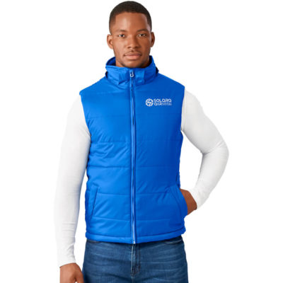 The Mens Evolution Bodywarmer is a nylon sleeveless body warmer with a diamond check pattern. Lined with a polyester and cotton blend and padded with 100% polyester. Features include slanted welt pockets, full zip, branded puller, chin protector, wind placket and inner pocket. With adjustable hemline toggles and an adjustable hood
