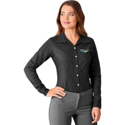 The Ladies Long Sleeve Aspen Shirt is a black cotton, polyester and oxford fabric blended button up shirt. With pearlised buttons, front and back darts, a back yoke, a curved hemline and two button adjustable cuffs.