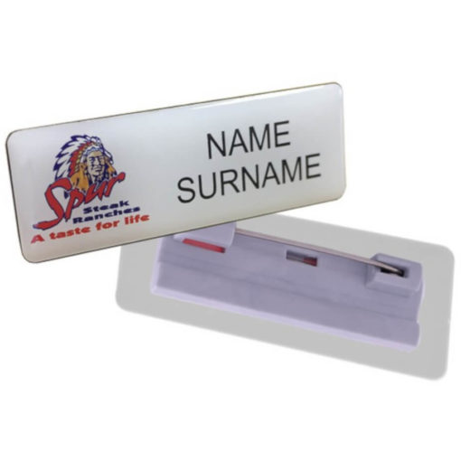 The Name Badge Pin Clip is a domed badge with a plastic pin clip. Available in a small rectangular shape