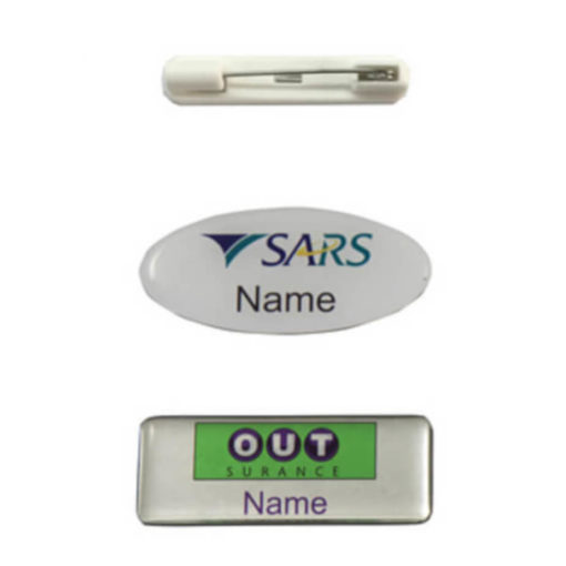 The Name Badge Pin Clip close up to display the plastic pin attachement. Badge is avilable in a variety of rectangular or oval shapes with a domed surface