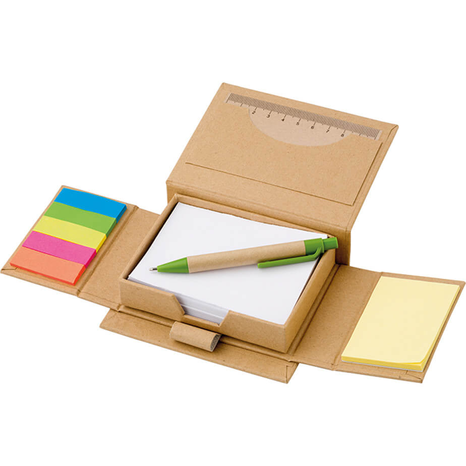 The Recycled Desk Organizer is a rectangular box shape that opens up with sticky notes, white pages, pen, pen loop and a ruler inside.