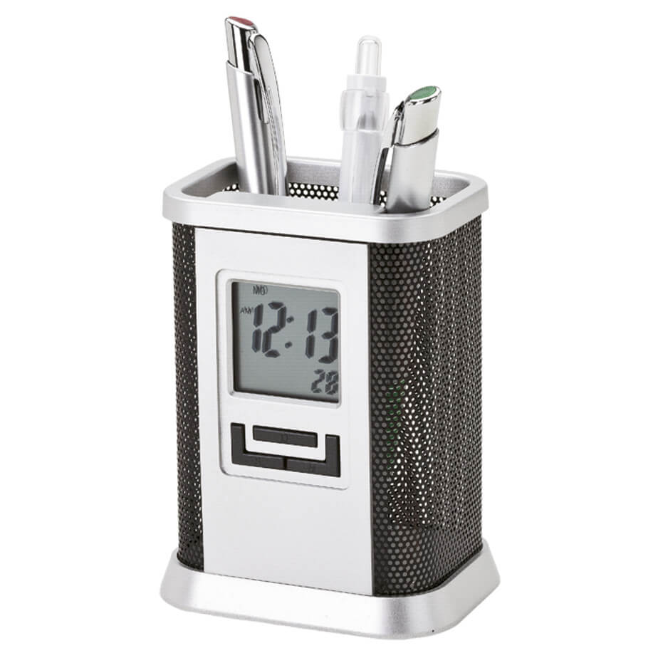 The Desktop Pen Stand with Alarm Clock has a silver metal and black metal mesh frame and can hold many pens. It is rectangular shaped with curved edges. The clock has a square screen and 3 black buttons.