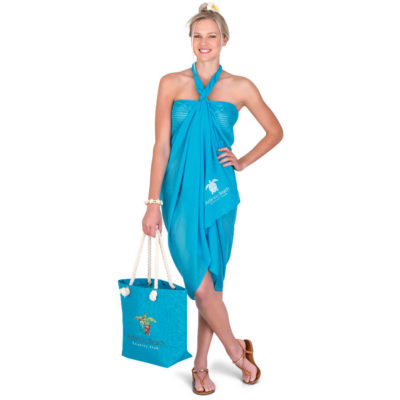 The Caribbean Beach Set in turquoise has a laminated jute beach bag with a cotton cord handle, a laminated jute cosmetic bag and a 100% polyester pareo (wrap around)