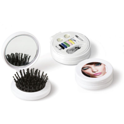 The City-Girl Mirror Is Made Out Of ABS. It Features A Collapsible Hairbrush And A Mirror With A Sewing Kit Under The Lid.