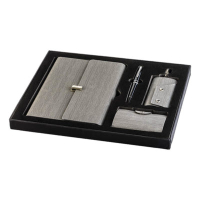 4 Piece Exclusive Gift Set Features A PU Cover, 4 Piece Gift Set, Key Holder, Notebook, Card Holder, Metal Pen And Metallic Clip Closure.