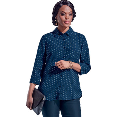 The navy-white Ladies Orchid Blouse is made from 100% polyester polka dot printed fabric with a constructed collar and three quarter sleeves. The shirt has a dropped shoulder, a high-low hem, side slits and turn up cuffs with buttons.