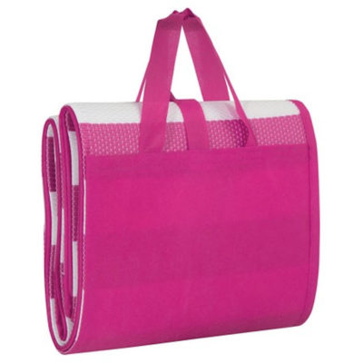 The pink Beach and Yoga Mat can be rolled up to display a carry handle.