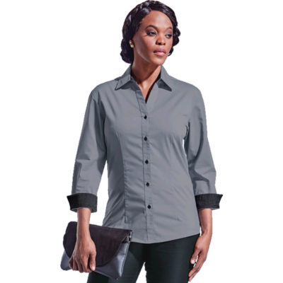 The Ladies Saga Blouse Is A Grey 73/24/3 Cotton Polyester Lycra Fabric, Stretch Poplin Fabric With Contrasting Inner Neck Tape And Cuffs. Features Front And Back Waist Darts, Cut Away Neck Line, 3/4 Sleeves And Contrasting Buttons