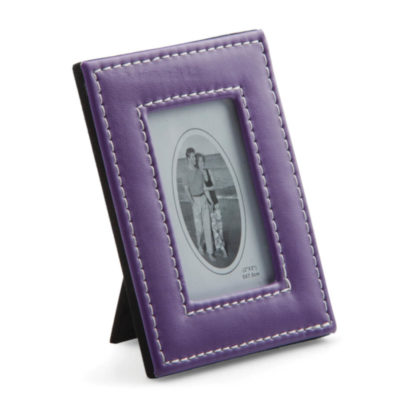 Frame your memories in something adorable and colourful with the Purple Small PU Photo Frame. Made from PU Leather, the photo frame is both durable and cute.