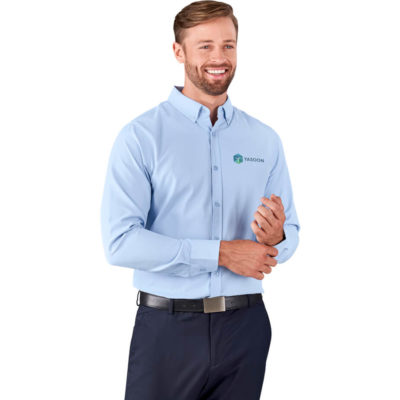 The Mens Long Sleeve Nottingham Shirt is a blended fabric long sleeve sky blue shirt with with adjustable cuffs, a button down collar and box pleat on back yoke. Curved hem