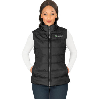 The Ladies Lando Bodywarmer is a black puffy bodywarmer with a full padded quilt. Full zip with chin protector, curved back hem and front panels with side welt pockets