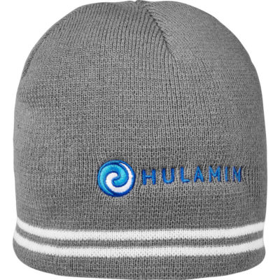 The Championship Beanie is made from an acrylic rib knit material in the colour grey with two wrap around white strips.