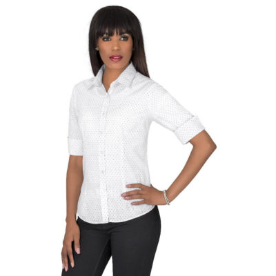 The Ladies 3/4 Sleeve Duke Shirt is trendy and a perfect combination of formal and casual wear. Made from 65% polyester and 35% cotton with a curved hem and side slits, with a small polka dot pattern.