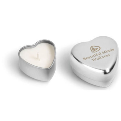 The Hearts On Fire Candle in a metal heart shaped casing with 35g of vanilla scented candle wax