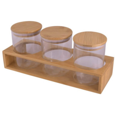 3 piece storage set made from glass and bamboo. Set includes three identical jars with bamboo insulated lids and comes in a bamboo stand for easy storage