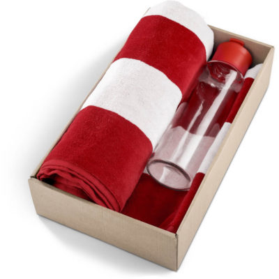 The Kooshty Summer Set - Phuket is a cotton rich red and white stripe towel with a glass bottle and matching red lid. Packaged in a brown box