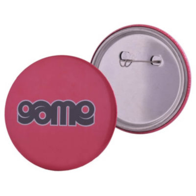 The Medium Button Badge with a 75mm diameter and a metal pen backing