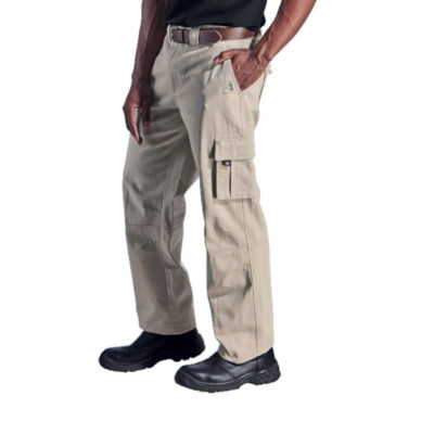 The Indestruktible Corporal Pants, Knee Panel With Dart Detail, Side Leg Below Pockets With Flap And Velcro, Indestruktible Branding, Slanted Hip Pockets With Loop & D Ring Detail, Metal Shank & Zip Closure, Heavy Double Top Stitch Detail, Bartracks At Stress Points, Back Pockets With Flap And Velcro, Made From 100% Cotton. Colour: Stone. Model.