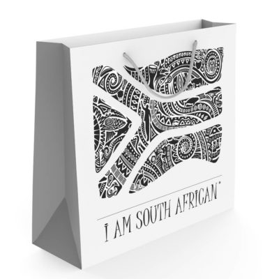 Andy Cartwright 'I Am South African' Gift Bag is white with a black tribal South African flag printed on the side. One of Andy Cartwrights collection.