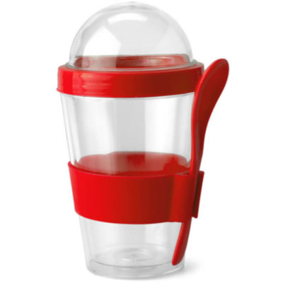 Red silicone band and matching spoon wrapped around a plastic drinking mug with separate container used as lid.
