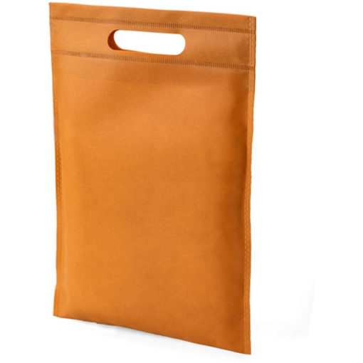 The Dayminder Mini Bag in the colour tan made from non woven material.