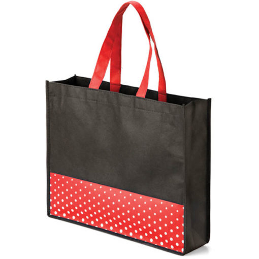 The Viva Tote bag with a red polka dot pattern made from non woven material.
