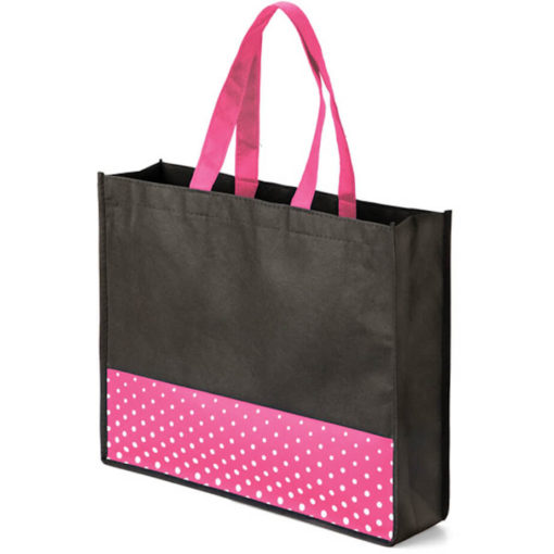 The Viva Tote bag with a pink colour polka dot pattern made from non woven material.