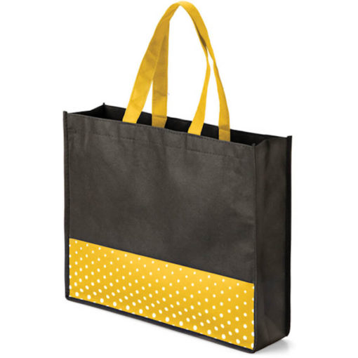 The Viva Tote bag with a yellow colour polka dot pattern made from non woven material.