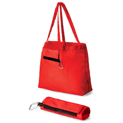 The Foldable Tote with Carabiner in the colour red and has a velcro closure.