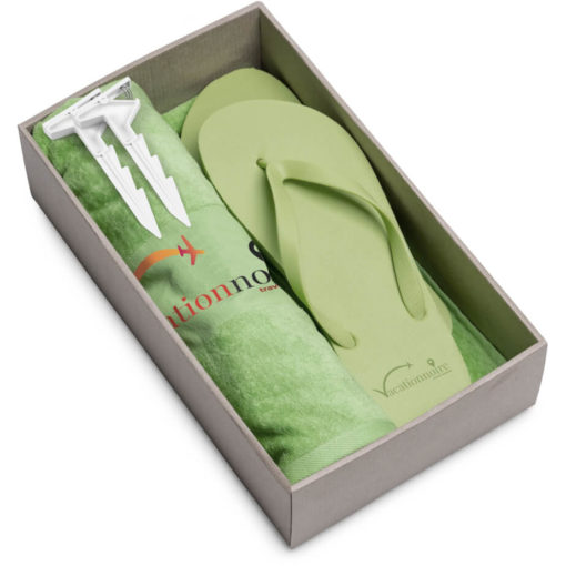 The Beach Break Summer Set includes a lime green 100% cotton towel, lime green EVA & PVC flip flops and a white plastic blanket clip. Packaged in a brown box