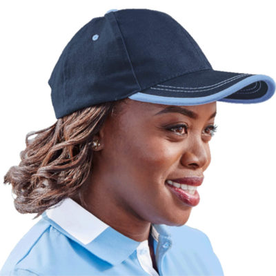 The 6 Panel Canvas Binding Cap is a heavy brushed cotton cap in navy with sky blue trimming detail along the peak and matching colour embroidered eyelets