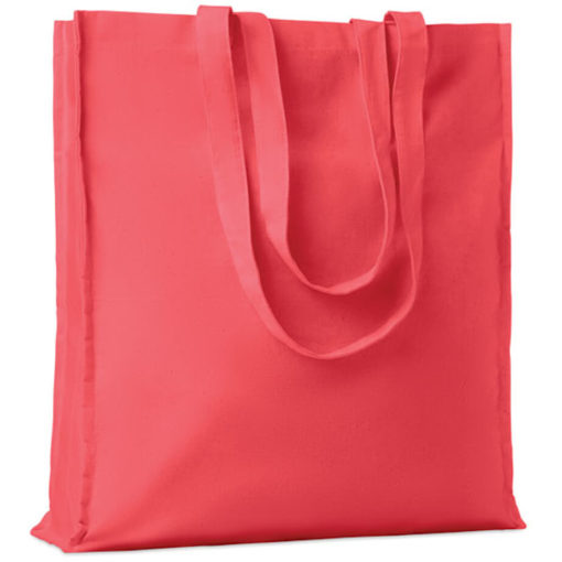 The Cotton Colour Shopper has long carry handles with added gussets, made from cotton and available in red.