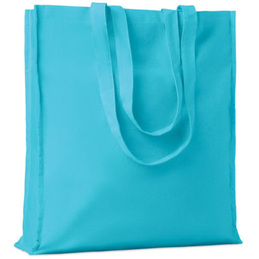The Cotton Colour Shopper has long carry handles with added gussets, made from cotton and available in turquoise.