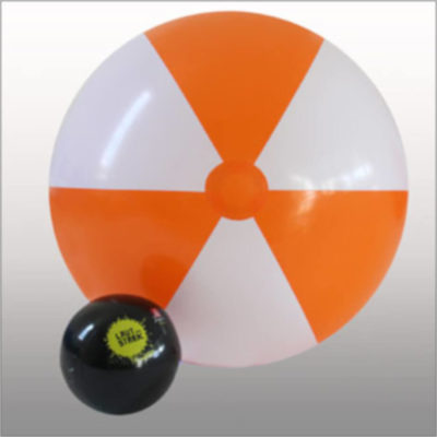 The 1.5m Beach Ball is a PVC 6 panel beach ball with alternating orange and white panels. Extra large in size with a black regular size beach ball for a size comparison.