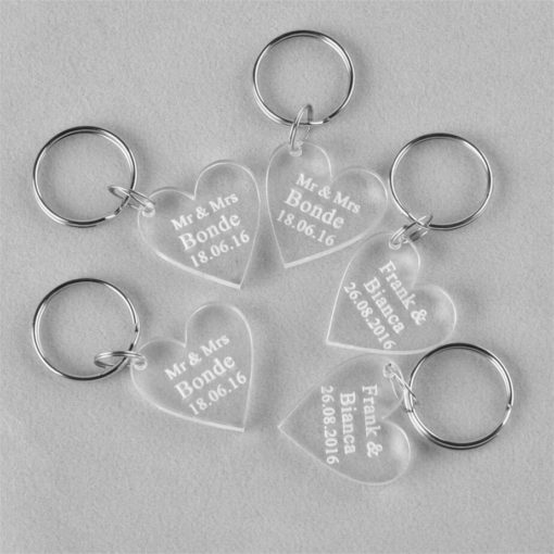 The Custom Shaped Keyring is a hard clear acrylic custom shaped keyring in heart shape with laser engraving. With a metal split keyring