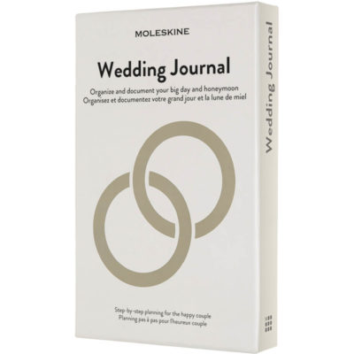 The Passion Journal - Wedding Box is a hardvoer notebook with rounded corners, lined acid free pages, an elastic band closure and silk ribbon bookmark. With Moleskine history reading material in the expandable inner pocket of the back cover