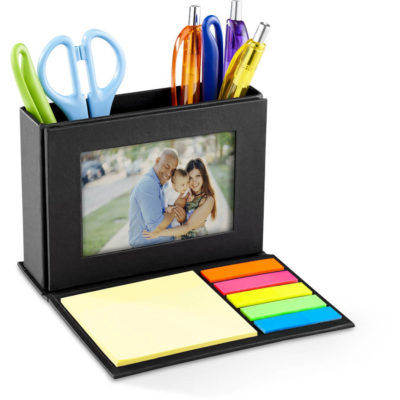 The Folding Photo Desk Caddy is made from 100% recycled paper that has a built in photo frame, with sticky notes.