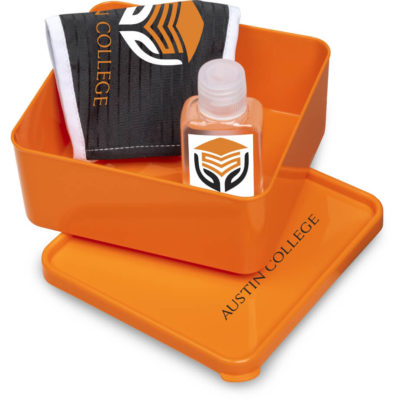 The Safety-1st Perry Kit is a back to school kit that contains one black double layer polyester facemask, an orange PP lunchbox with secure fitting lid and a 50ml waterless gel sanitiser in a PET bottle with a flip-tip lid