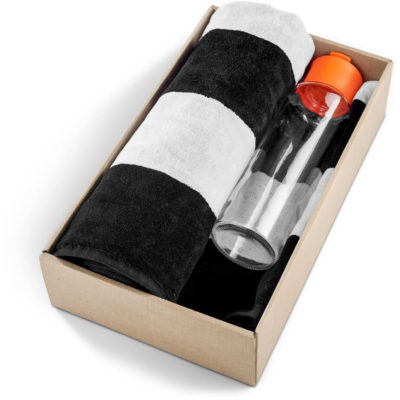 The Kooshty Summer Set - Bali is a summer time gift set that includes a large black and white stripe 100% cotton towel and a 700ml glass drinking bottle with an orange PP lid. Packaged in a gift box