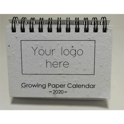 The Growing Paper Calendar is a desk calendar with a metal spiral spine and features 12 sheets of recycled paper that each contain seeds to be planted. The calendar can be branded in the top left corner of each month and states the seed of the month in the top right corner