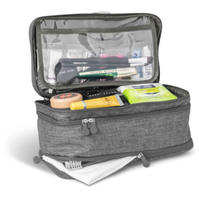 The Santa Monica Deluxe Toiletry Bag is a grey 600D fabric bag with three storage compartments, zippered closures, zip pullers, individual storage pouches on the top flap and a top carry handle
