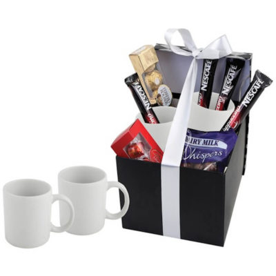 The Sublimation Coffee Hamper includes 2 x 330ml Sublimation Mugs, 1 x Packet of Whispers, 1 x Ferrero Rocher Box, 1 x Lindt Lindor Box and 4 x Cappuccino Sachets